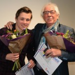In de bloemen , draagspeld en oorkonde!, young meet old..er